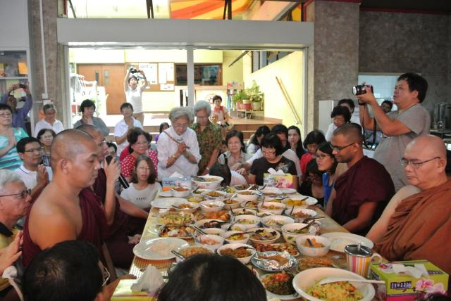 Devotees, well-wishers and participants gathered round the monks' table received blessings followed by transference of merits.