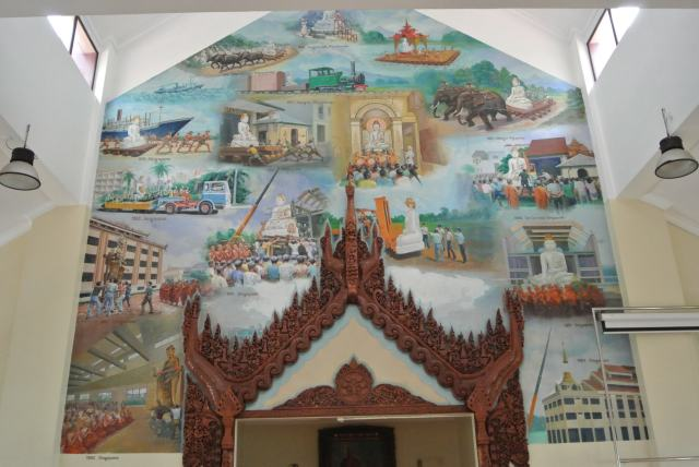 Murals on the wall depict the epoch of the 11 feet 10 tons marble image of the Buddha travelled from Mandalay to installation at the Burmese Buddhist Temple at Tai Gin Road.