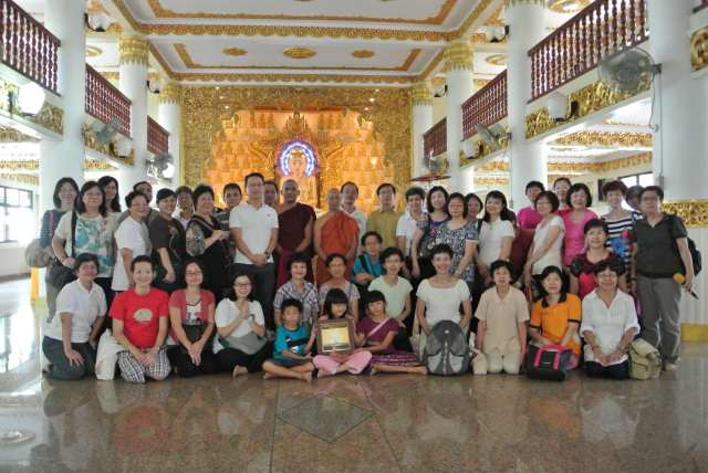 Group picture at Burmese Buddhist Temple with the 11-feet 10 tons Buddha image in the background.