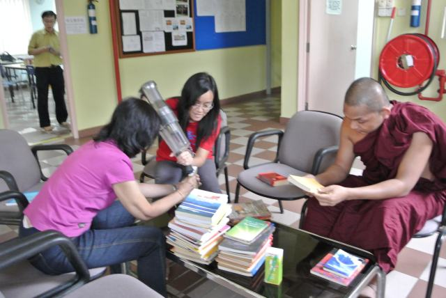 Cleaning books with portable vacuum cleaner other than paper kitchen towels and cleaning cloth to get of the dust, dirt and filth accumulated on some books donated more than half century ago since 1960