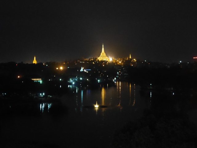 Night shot of Shwedagon Pagoda glittering in gold. Image captured from hotel balcony.