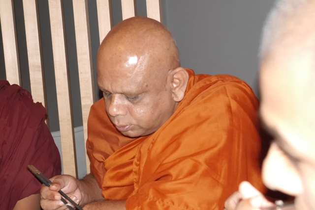 Venerable Professor Gallelle Sumanasiri, Vice Chancellor of Buddhist and Pali College, is dexterous and manipulative with a pair of chopsticks.